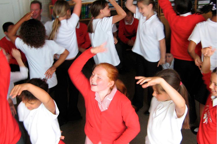 children dancing - part of a Kevin Graal storytelling in schools project