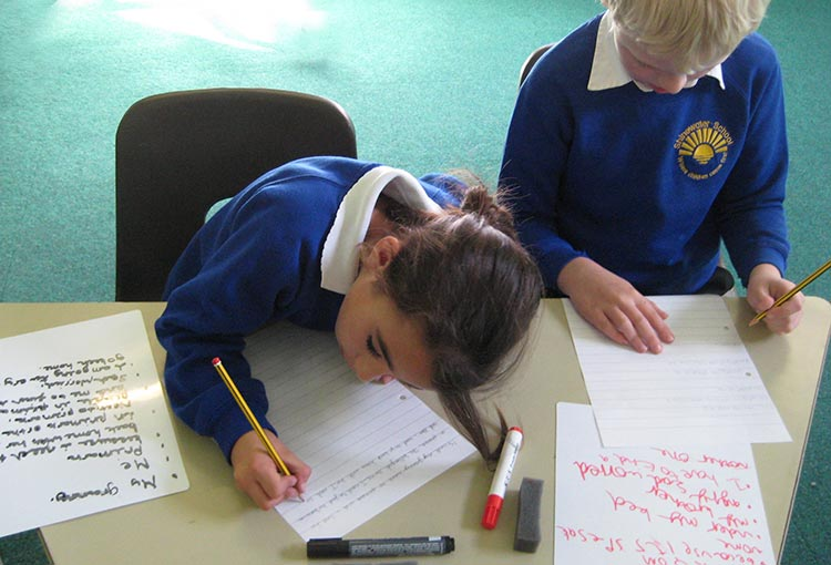 children writing in a Kevin Graal storytelling & writing project for schools